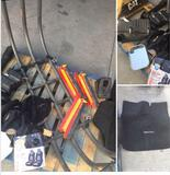 Grouping of assorted car parts. Truck bed extender, seat covers, reflectors,etc