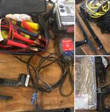 Grouping of car accessories Jumper Cables, Maintainer, Cargo net, & Misc. tools