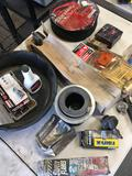 Assorted new and used car parts