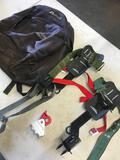 Everest bag, pair tree climbing spikes, etc