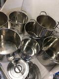 9 pieces. 7 assorted stock pots 2 lids