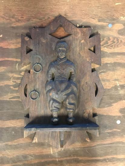 Antique oak wall plaque with Dutch boy