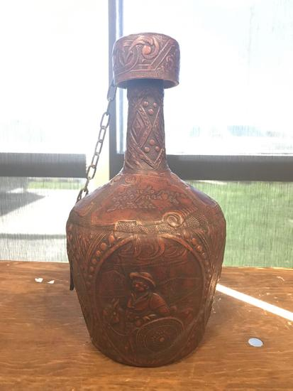 Vintage Spanish leather covered decanter featuring Don Quixote