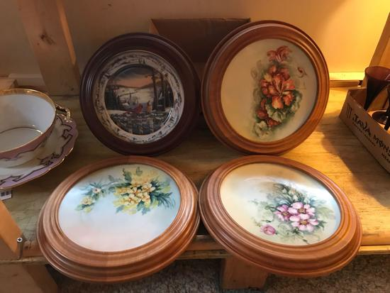 Group of four framed plates