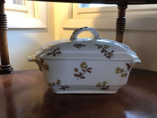 Vintage covered dish with floral design and spoon