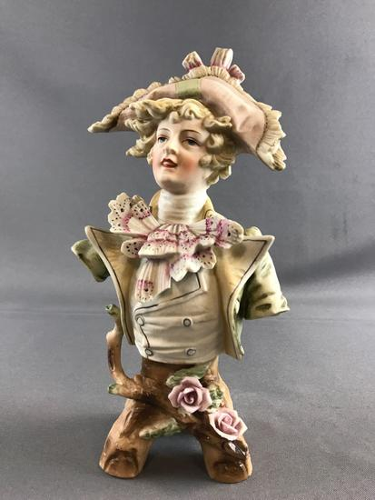 Vintage porcelain figure bust on tree stump