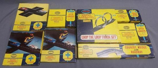 Lot of (8) Aurora Model Motoring Race Track Accessories.