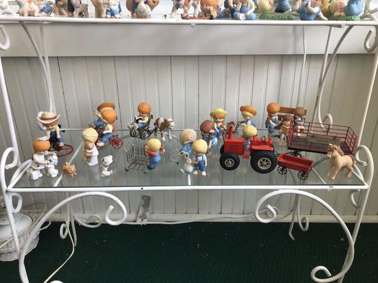 Shelf lot of enesco Country cousin porcelain figurines