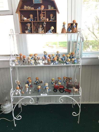 Metal shelving unit with glass shelves