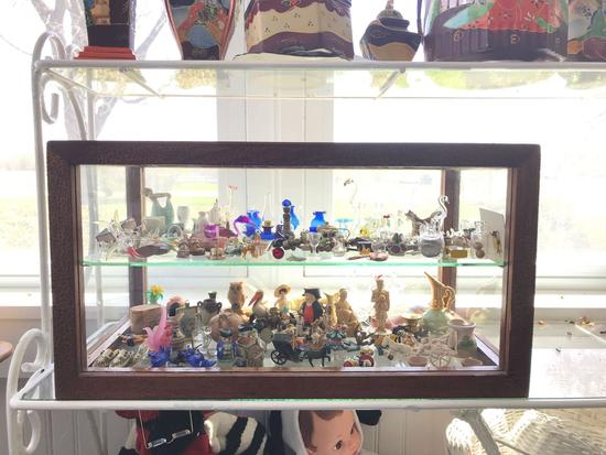Vintage knickknacks and miniature collection in antique glass showcase