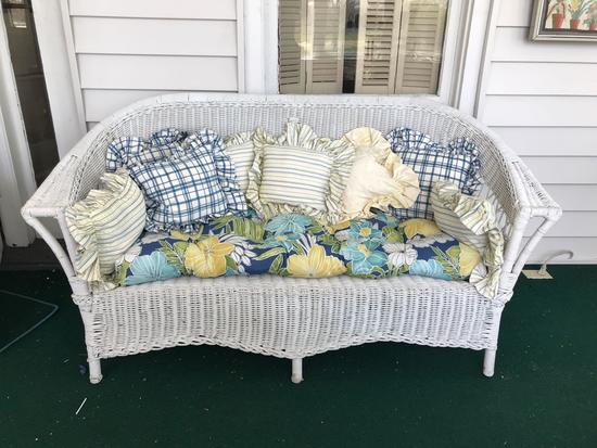 Antique wicker couch with pillows