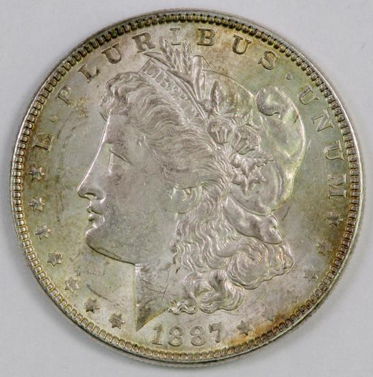 1887 P Morgan Silver Dollar.
