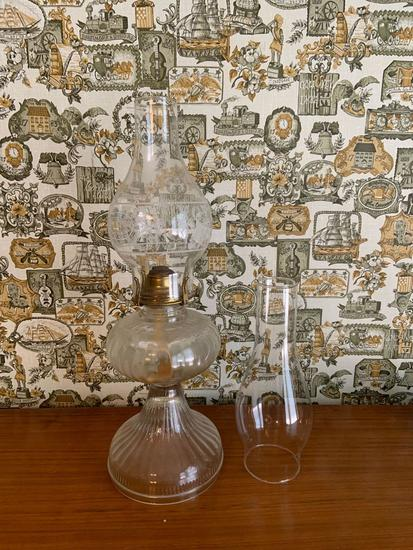 Antique oil lamp with extra chimney