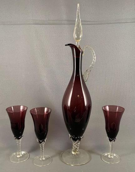 Four piece amethyst glass ewer set with stem glasses