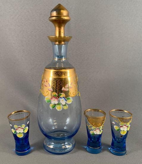Vintage four piece glass decanter set with enamel floral design