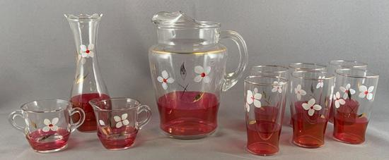 Group of 10 ruby flash glass items with floral design