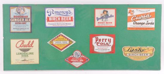 Group of Vintage Soda and Beer Advertising Bottle Labels in Glass Display