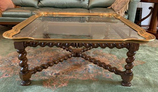 Antique coffee table with turned legs and glass