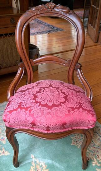 Antique wooden upholstered chair