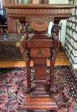 Antique Walnut pedestal Book Stand with ornate griffin design