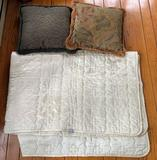 Group of pillows and blanket