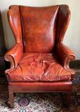 Vintage brown/red leather wing backed chair