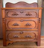 Antique wooden washstand with ornate carved pulls