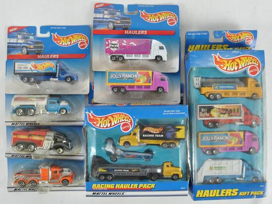 Group of 8 Hot Wheels Haulers Die-Cast Vehicles in Original Packaging