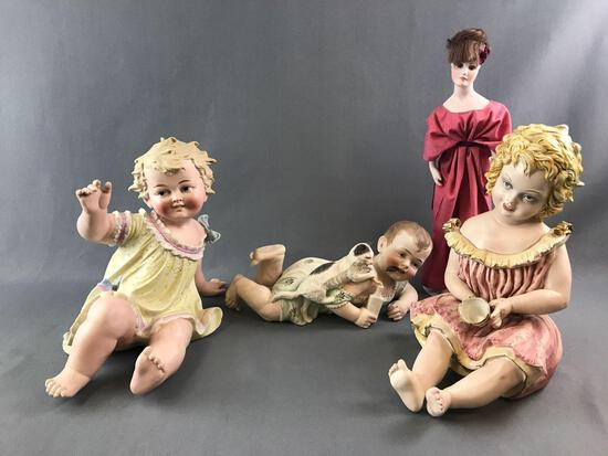 Group of vintage antique piano babies and doll
