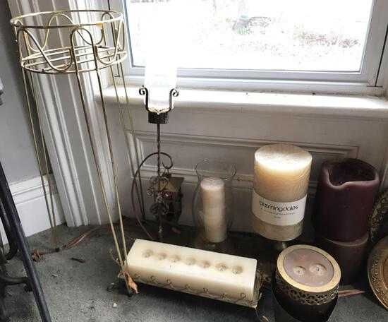 Group of candles, candle holders and plant stand