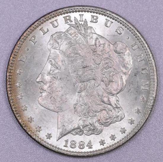 1884 P Morgan Silver Dollar.