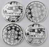 Group of (4) 1oz. .999 Fine Silver Seasons Greetings Rounds.