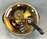 Vintage Brass and Metal Hand Crank Industrial Gear in Housing