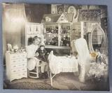 Antique photograph of little girl with dollhouse and dolls