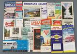 Group of vintage travel pamphlets, maps and more