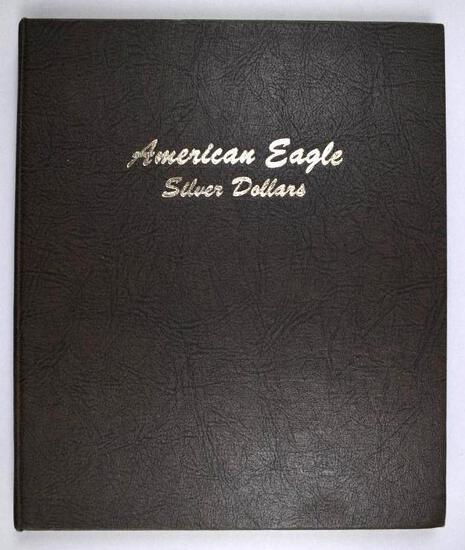 Dansco Album containing (30) 1oz. American Silver Dollars BU