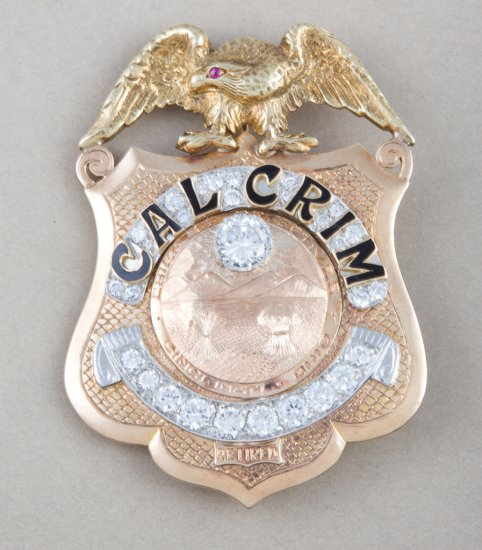 "Heavy 10 Kt. gold shield Badge with eagle crest.  Engraved on back ""To Commemorate 75th Birthday of"