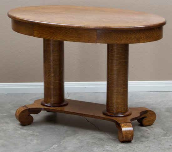 Beautiful antique, oval, double pedestal, quarter sawn oak Library Table, circa 1900-1910, with hide