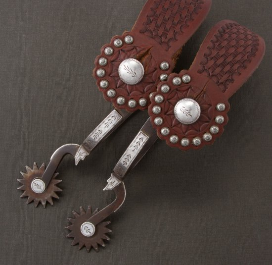 Pair of Louis Bryant marked, double mounted Spurs with engraved silver overlay and bottle opener sty