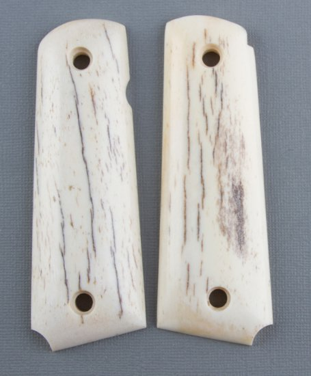 Beautiful pair of polished sheep horn Grips for a Model 1911, excellent condition.