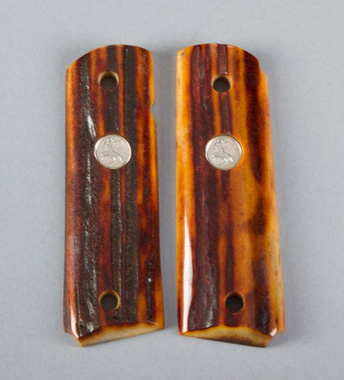 Pair of polished stag horn Grips for a Model 1911 Automatic, with inlaid Colt medallions.