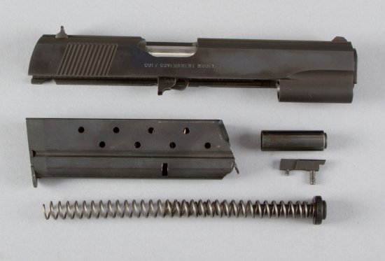 Conversion Kit for a Colt Mark V, Series 80, 9X23 WIN Caliber, which consists of slide, barrel, spri