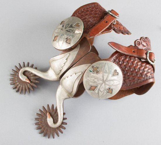 Fancy pair of single mounted Spurs by noted Bit & Spur Maker Randy Butters, #262, with silver hand e