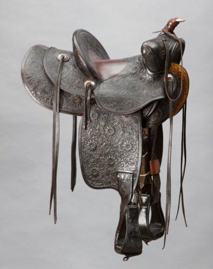 "Beautiful, highly tooled Saddle, marked ""Edward H. Bohlin, Maker, Hollywood, Cal."", 12"" seat, 4"" can"