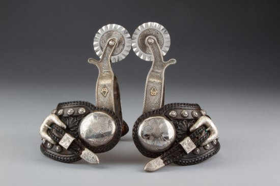 """Outstanding pair of """"Edward H. Bohlin, Hollywood, CA."""" marked, engraved silver overlay Spurs, full m"""