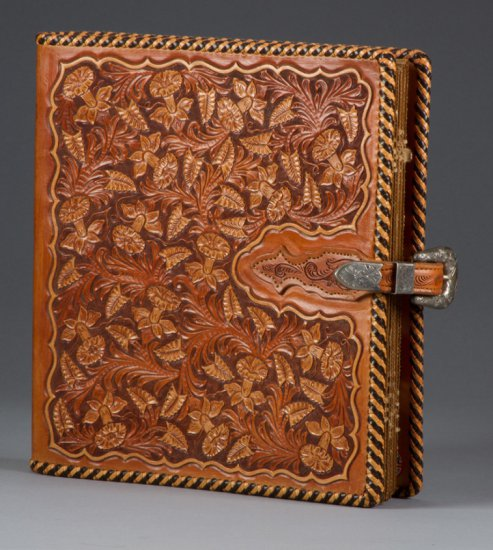 """Fantastic carved leather Binder by noted artist, the late Bob Dellis, (1928-2002), 12"""" x 10 1/2"""", fl"""
