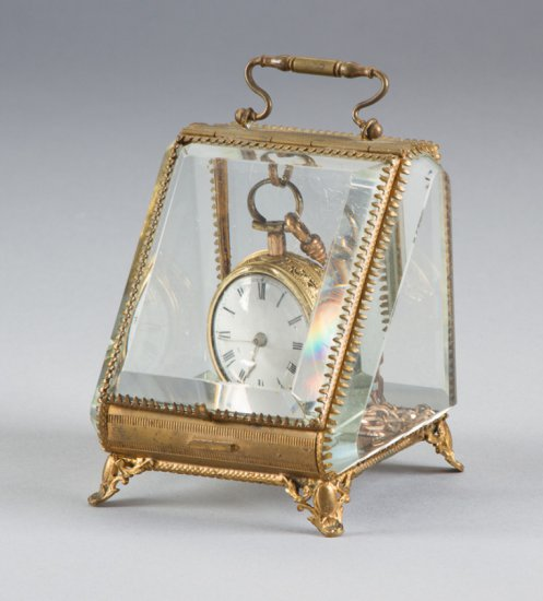 """Unique and ornate, brass and beveled glass, footed Watch Display, measures 4"""" T x 3 1/2"""" W, with han"""