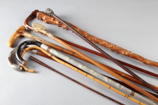 This lot consists of seven Walking Sticks and two wooden Blackboard Pointers, totaling nine pieces: