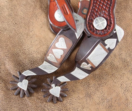 Fine pair of double mounted, hand engraved, sterling overlay Spurs by noted Texas Bit & Spur Maker W