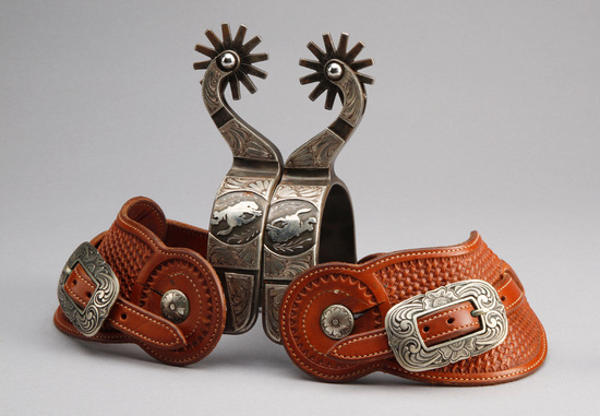 Outstanding pair of Gary Blackwood, Texas marked single mounted, hand engraved silver overlay Spurs